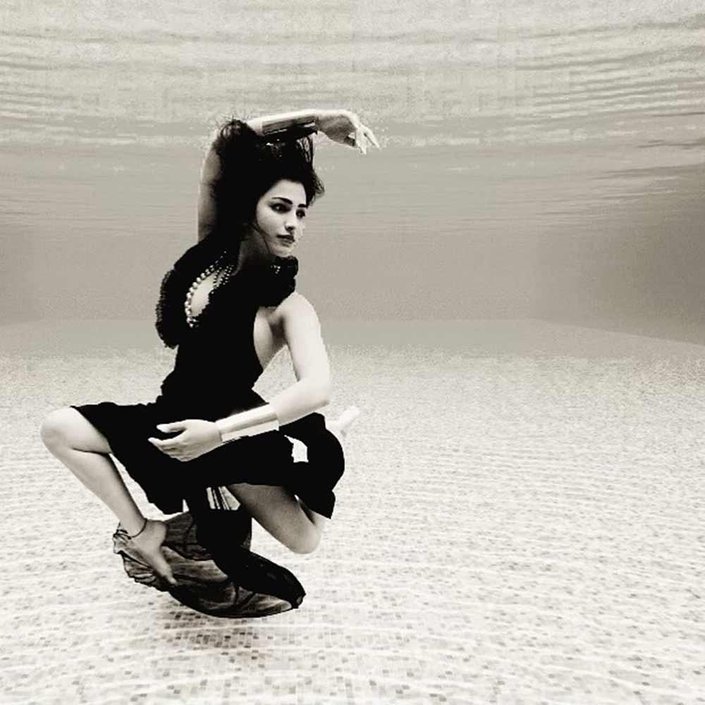 Shruti Haasan under water photo in a black swimsuit