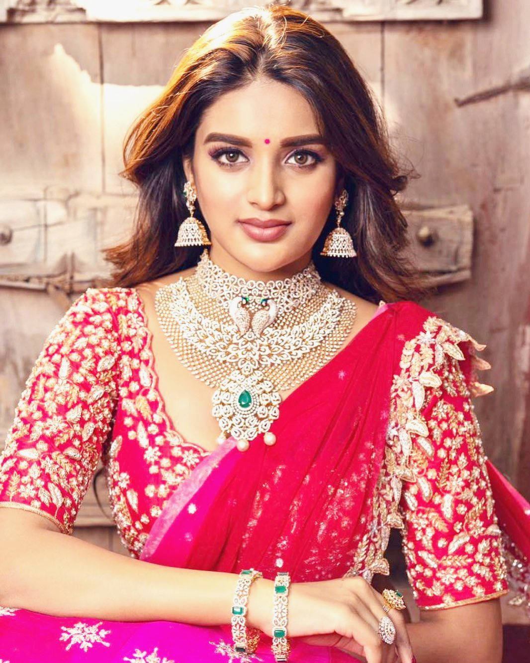 Niddhi Agerwal in red saree