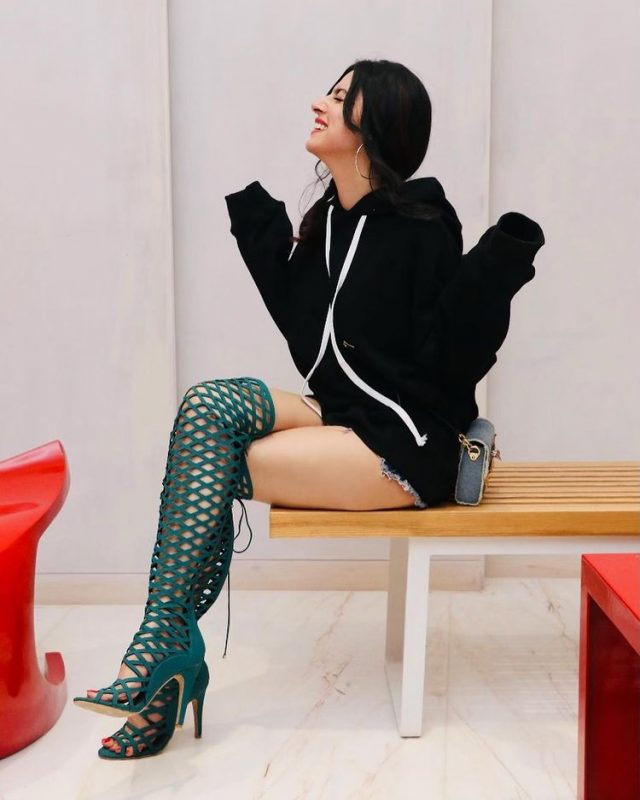 divya khosla kumar in black hoodie with teal boots looking amazing pictures