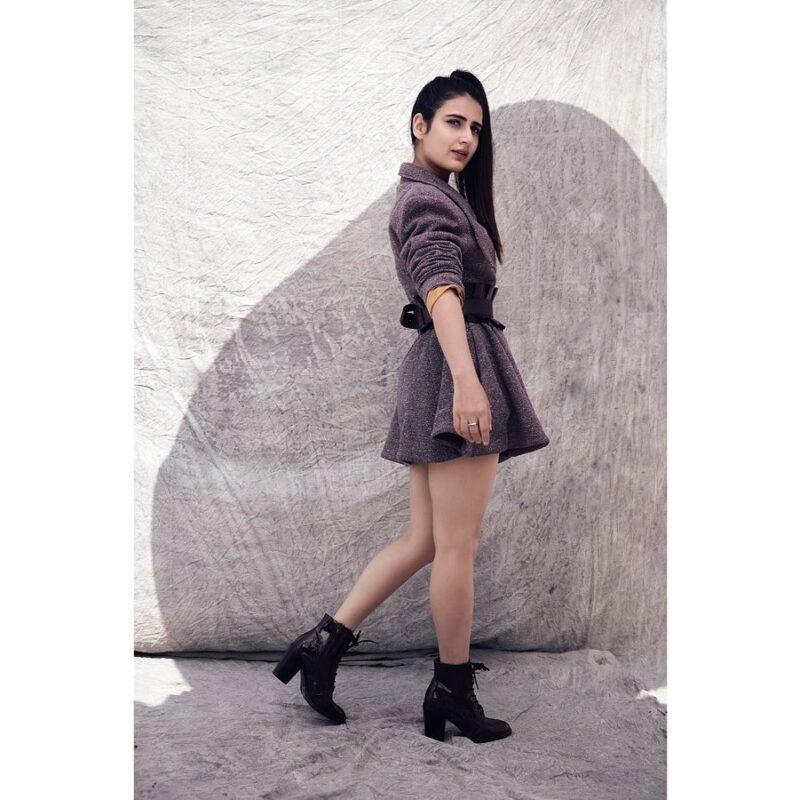 Fatima Sana Shaikh in Charcoal peplum dress and high heels in black boots
